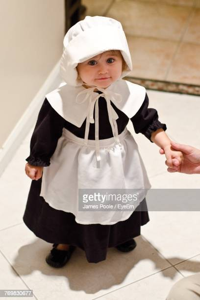 High Angle Portrait Of Cute Girl Wearing Nun Costume During Halloween