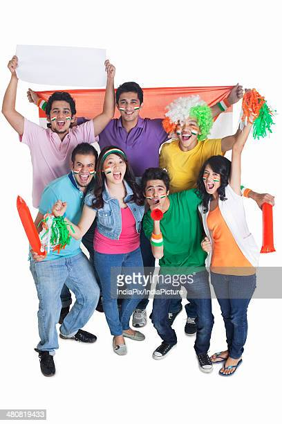 High angle portrait of excited fans cheering over white background