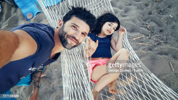 High Angle Portrait Of Girl With Father At Beach