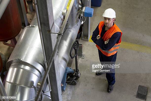 high angle portrait of male technician in power station - sigrid gombert stock pictures, royalty-free photos & images