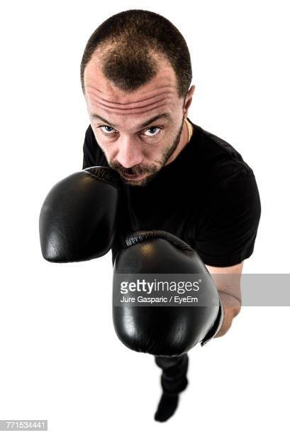 High Angle Portrait Of Mid Adult Man Wearing Boxing Gloves Against White Background