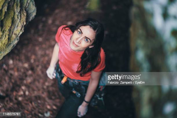 High Angle Portrait Of Smiling Young Woman Standing In Forest