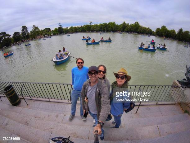 High Angle Portrait Of Tourists Standing On Steps By Lake