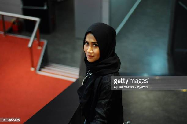High Angle Portrait Of Woman In Hijab Standing On Stairs
