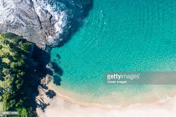 high angle scenic view of rock formation by sea during sunny day - laguna beach california stock pictures, royalty-free photos & images