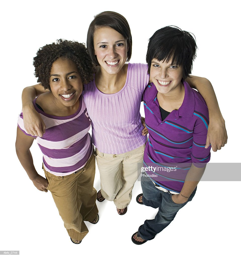 high angle shot of a group of three teenage female friends as they look up and smile : Foto de stock