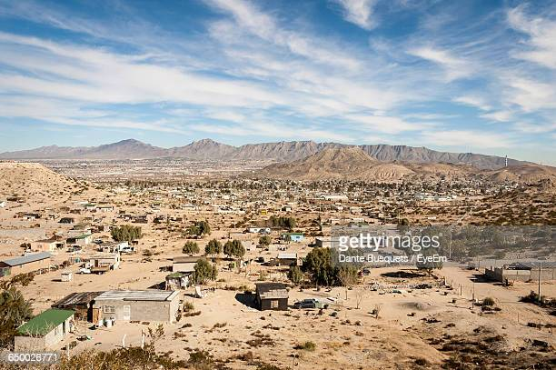 high angle shot of built structures on landscape - ciudad juarez stock photos and pictures