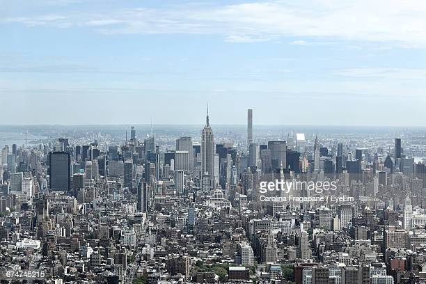 high angle shot of cityscape against calm sea - carolina fragapane stock pictures, royalty-free photos & images