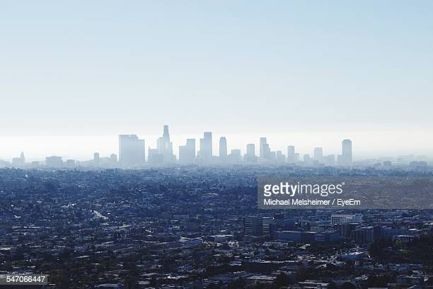 high angle shot of cityscape against clear sky - costa mesa stock photos and pictures