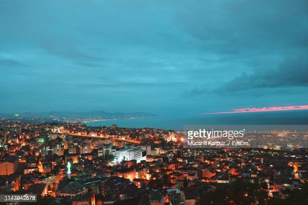 high angle shot of illuminated cityscape against sky at dusk - trabzon stock photos and pictures