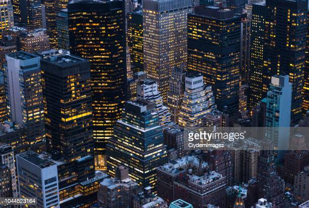 high angle shot of large group of skyscrapers in manhattan, new york city - midtown manhattan stock pictures, royalty-free photos & images