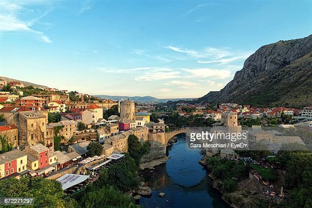 High Angle Shot Of River With Bosnian Cityscape In Background