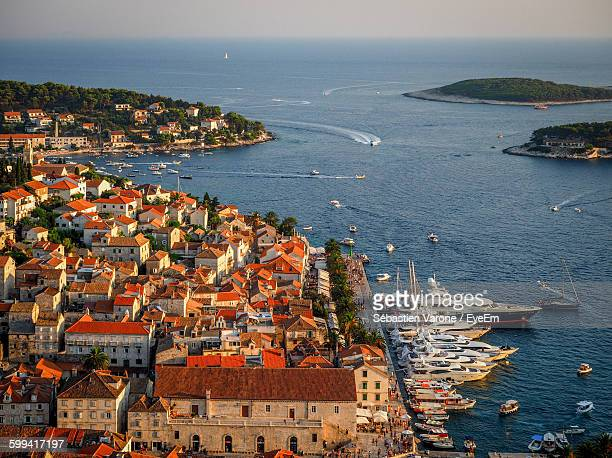 high angle shot of town against the sea - hvar stock photos and pictures
