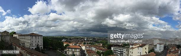 High Angle Shot Of Townscape Against Clouds