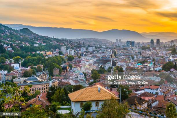 high angle shot of townscape against sky at sunset - sarajevo stock-fotos und bilder