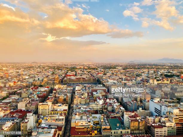 high angle shot of townscape against sky at sunset - mexico city stock pictures, royalty-free photos & images