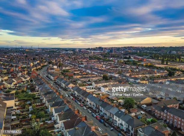 high angle shot of townscape against sky at sunset - newport wales stock pictures, royalty-free photos & images