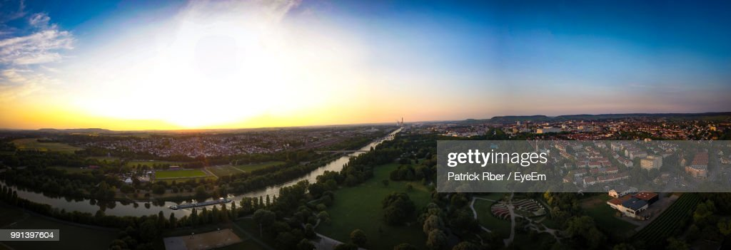 High Angle Shot Of Townscape Against Sky At Sunset : Stock Photo