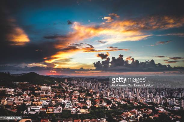 high angle shot of townscape against sky during sunset - belo horizonte stock pictures, royalty-free photos & images