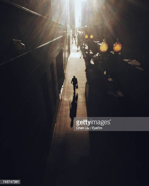 High Angle Silhouette Person Walking On Street Amidst Building In City