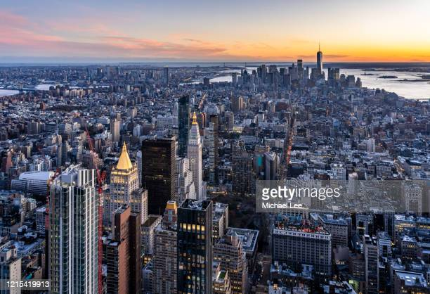 high angle sunset midtown skyline view - new york - madison avenue stock pictures, royalty-free photos & images