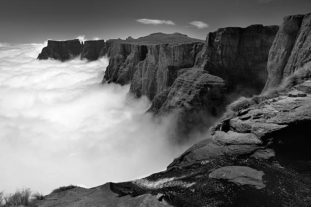 High angle view black and white view of Amphitheatre range with Tugela Falls in foreground, Drakensberg uKhahlamba National Park, Kwazulu-Natal, South Africa