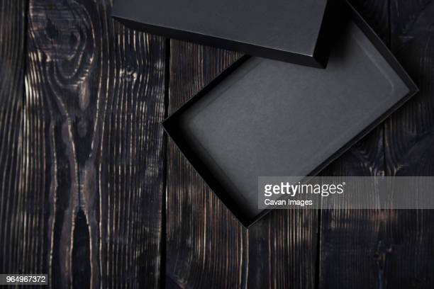 high angle view black empty gift box on wooden table - gift box stock pictures, royalty-free photos & images