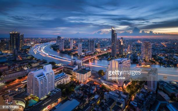 high angle view cities, building and chaophraya river curve at twilight - impossiable stock pictures, royalty-free photos & images