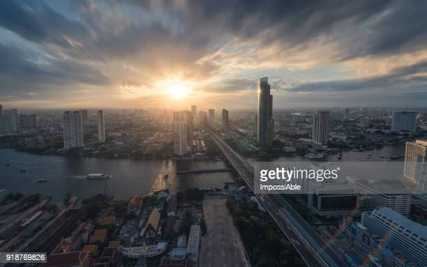 high angle view cities, building and chaophraya river curve at sunset - association of southeast asian nations stock photos and pictures