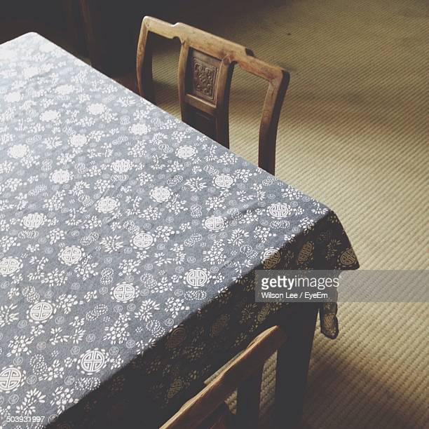High angle view designed cloth on dining table at home