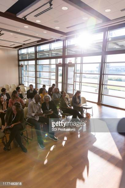 high angle view expo audience anticipating first speaker - town hall meeting stock pictures, royalty-free photos & images