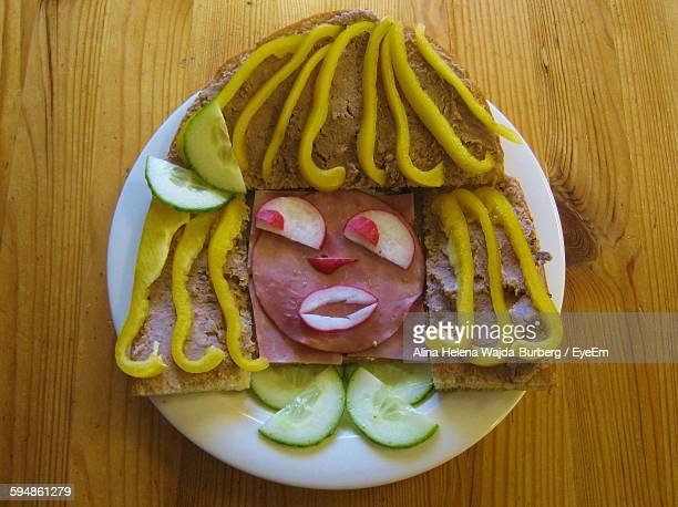 High Angle View Female Face Made From Bread And Vegetables