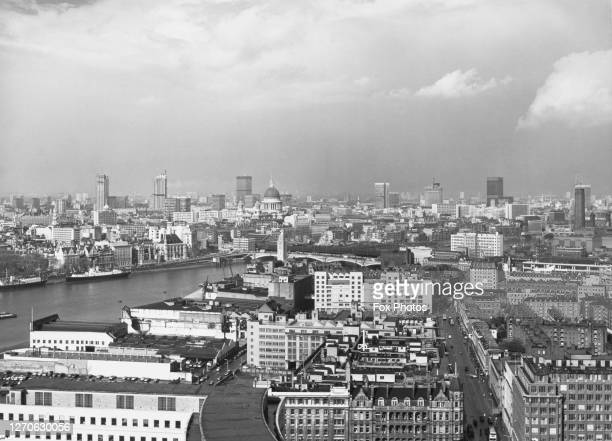High angle view looking towards the Oxo Tower and Blackfriars Bridge over the River Thames with St Paul's Cathedral visible in the distance in the...