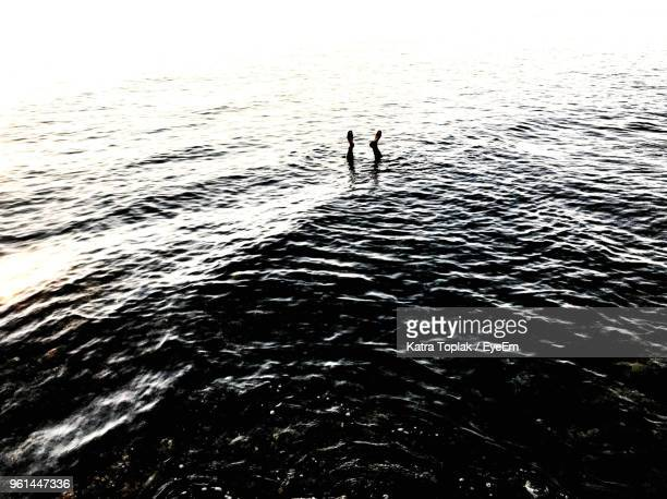 High Angle View Man Drowning In Sea