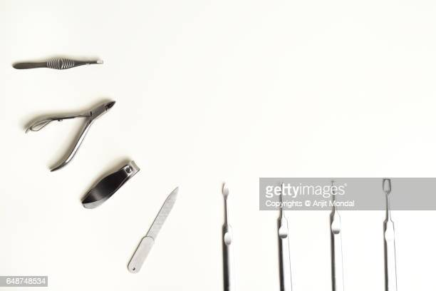 High Angle View Manicure And Pedicure Tools On White Desk With Copy Space