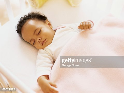 High Angle View Of A Baby Girl Sleeping In A Crib High Res