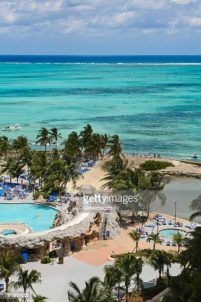 high angle view of a beach, cable beach, nassau, bahamas - cable beach bahamas stock photos and pictures