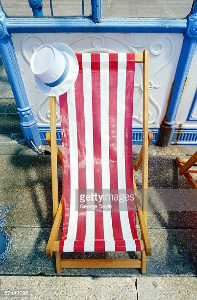 high angle view of a beach chair with a hat on it