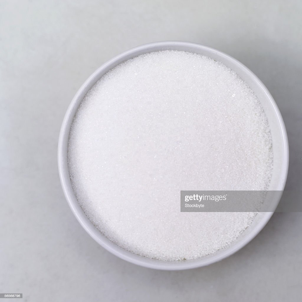 high angle view of a bowl of white sugar : Stock Photo