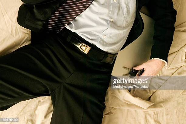 High angle view of a businessman sleeping on a bed