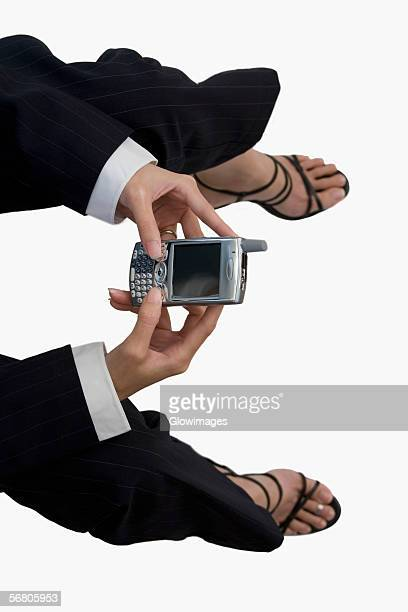 High angle view of a businesswoman holding a mobile phone
