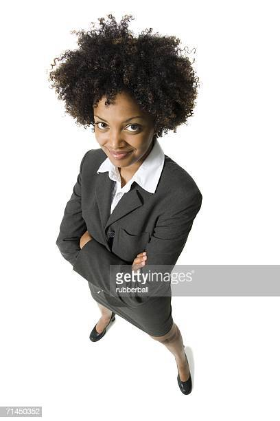 high angle view of a businesswoman with arms crossed - 若い女性一人 ストックフォトと画像