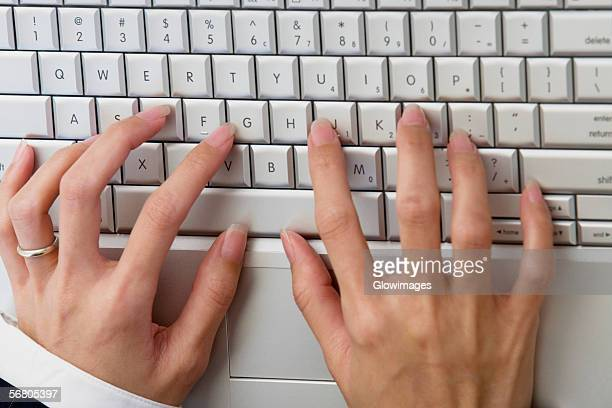 High angle view of a businesswoman's hands on a laptop