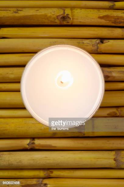 High angle view of a candle on bamboo, tranquil scene