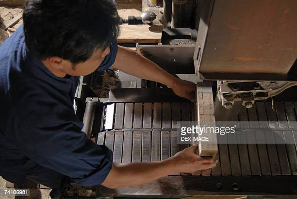 High angle view of a carpenter working in a workshop