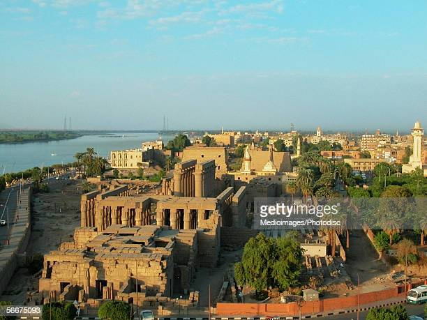 high angle view of a city on the banks of a river, nile river, luxor, egypt - luxor thebes stock pictures, royalty-free photos & images