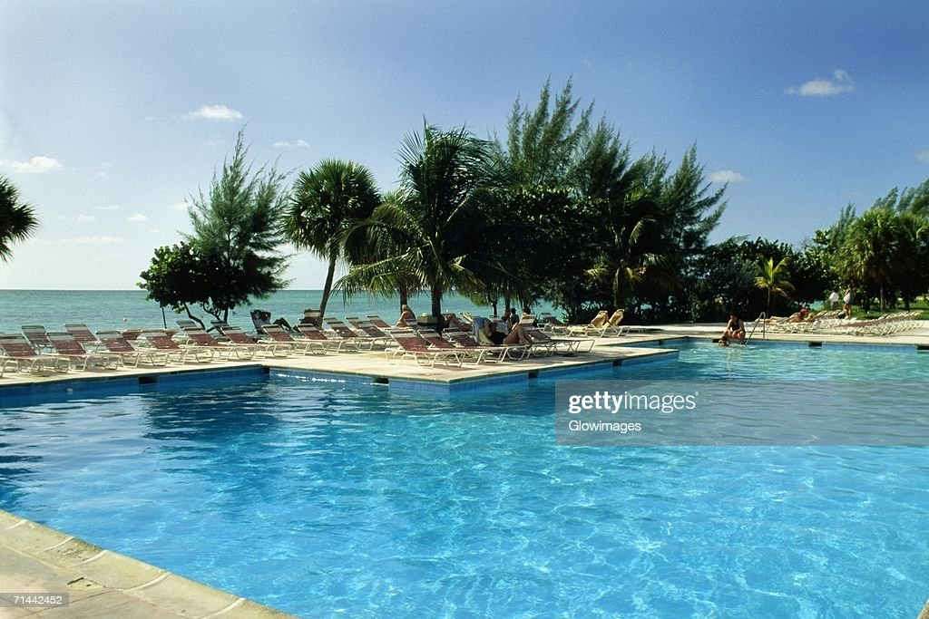 High angle view of a clear swimming pool at Lucayan Beach Resort, Freeport, Bahamas : Stock Photo