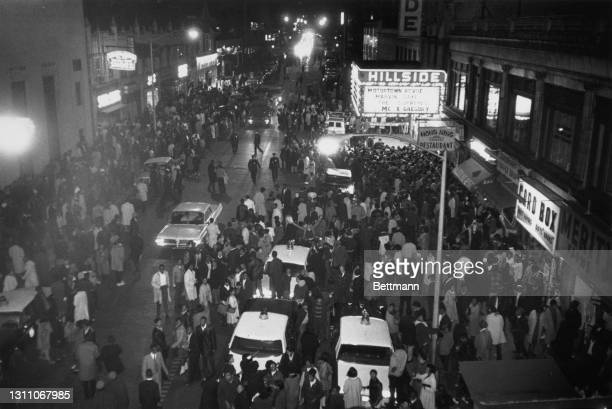 High angle view of a crowd of people on the street outside the Hillside Theatre awaiting a performance of the 'Motortown Revue' but overselling of...