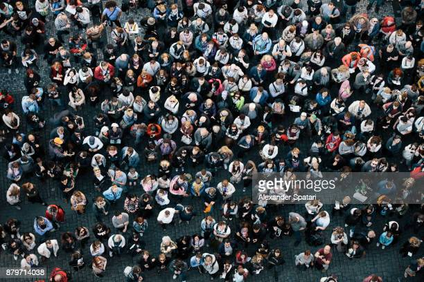 high angle view of a crowded square - individuality stock photos and pictures
