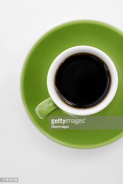 High angle view of a cup of black tea on a saucer